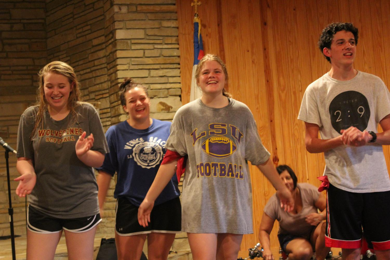 New student Braden Cowart (right) participates in Junior Senior Retreat with fellow Northlake students. Groups from the retreat created cheers and performed them for other groups.