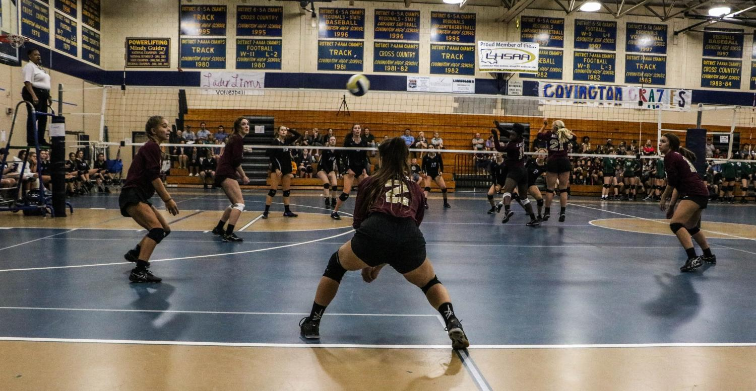 The Varsity Volleyball team prepares for the season with the pre-season jamboree.
