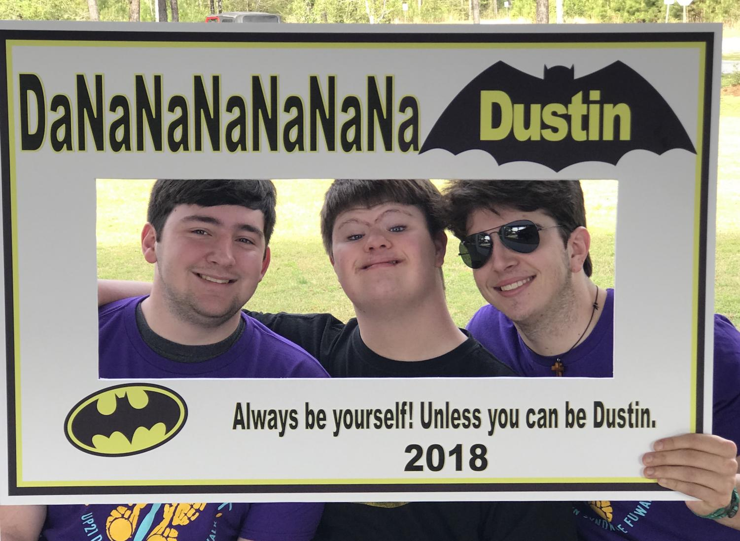 Senior Taylor Bourgeois stands with his cousins Dustin Gary (middle) and Cameron Gary (right) at the Up 21 Down Syndrome Awareness Walk on Saturday, March 24.