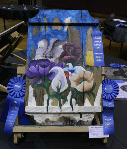 "Caroline Ellzey, a Northlake junior, received the ""Best of Show"" award for her submission: a representation of the senses, delivered through multiple mediums on canvas."