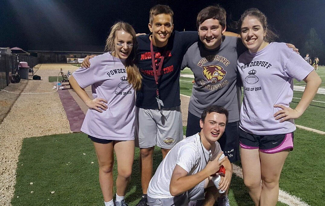 Taylor Bourgeois (third) attends a Powder Puff game his junior year with friends Morgan Marullo, Josh Holloway, Abigail McLain and Tyler Mussachia.