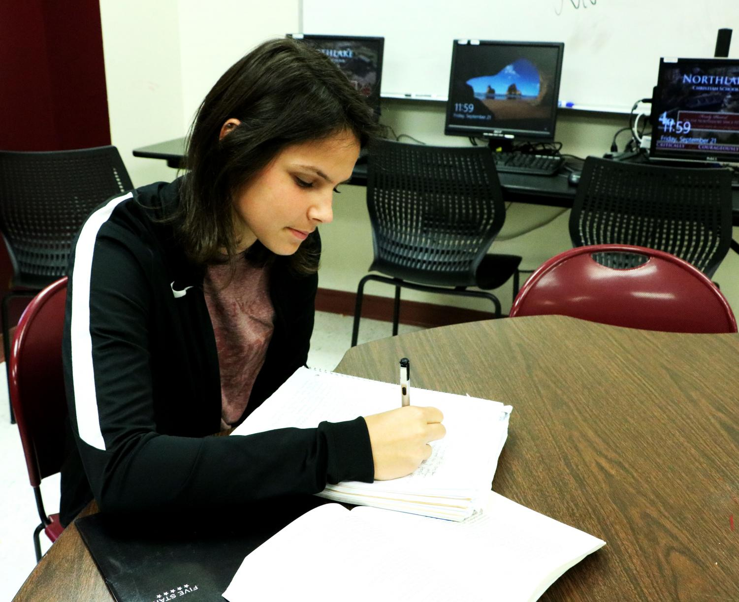 Growl editor Kara Lewis spends time in the Wolverine Den completing homework.