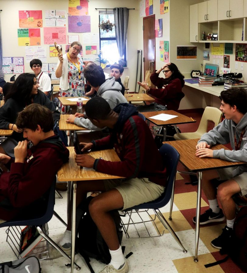 Science teacher Aleta Overby   walks among the rows of students during a lesson.