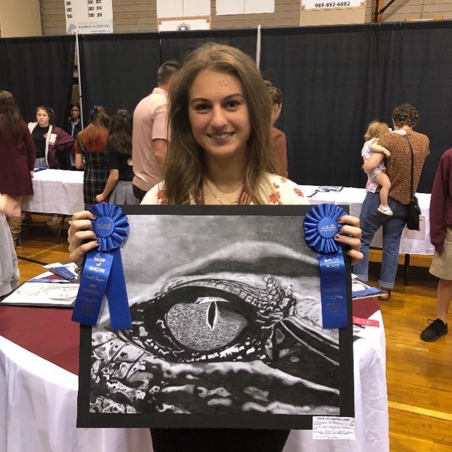 Junior Maddie McKean won  Best of Show in the high school division with her piece Crocodile Eye in the category of black and white drawing. She also was recently recognized for winning first Place in the VFW Young American Creative Patriotic Art Contest.