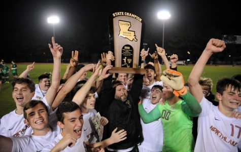 The Northlake Men's soccer team celebrates with Head Coach Nick Chetta after winning the 2018-2019 season State Championship Game over Isidore Newman.