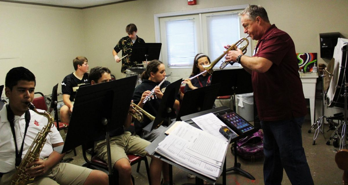 Band Director Gary White (right) leads class in a 10 minute warm up.