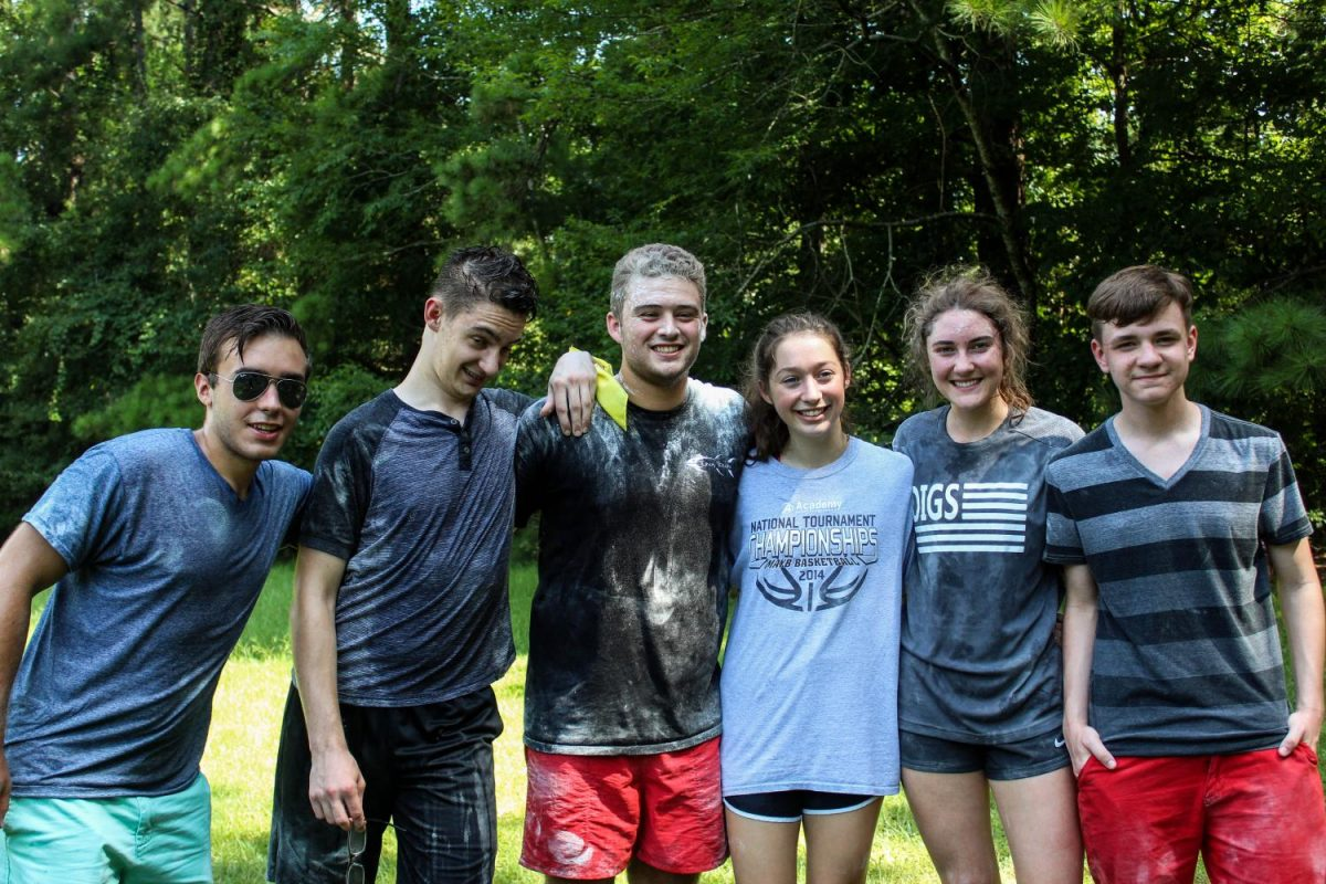 Juniors and Seniors gather after a flour war where they ran around and hit their opponents with flour filled objects.