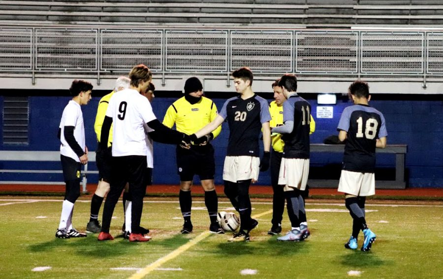 Captains shake hands before the kick off of the game.