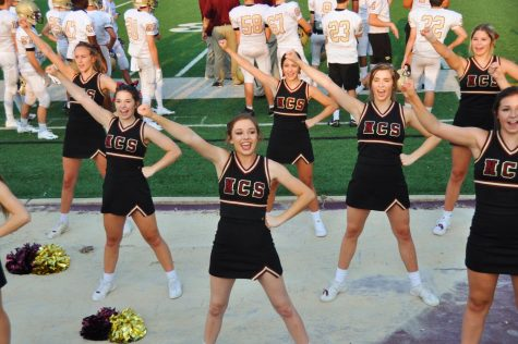 Varsity cheer team prepares to take on the 2018-2019 year as one