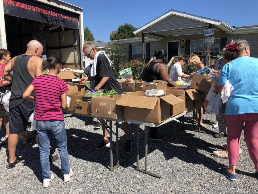 The Pura Vida club partnered with the New Orleans Mission to serve groceries to a community in Pearl River.