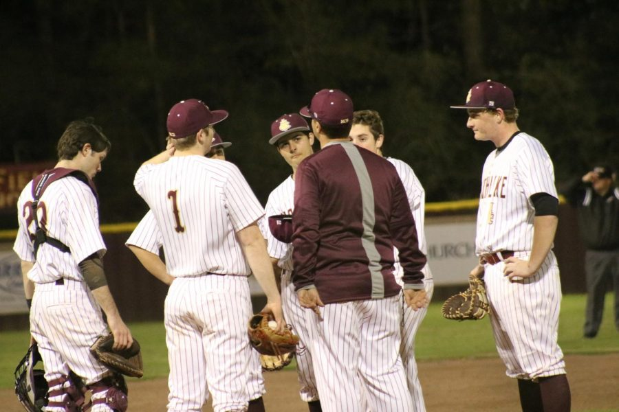 The+Wolverine+Baseball+team+gather+around+the+mound+mid-game+to+make+adjustments+with+Coach+Cam.