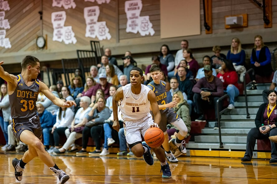 Sophomore Tony Walker dribbles the ball in a game against district opponent Doyle.